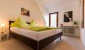 Ferienwohnung Bangbüx St Peter Ording Dorf Hund Doppelbett Schlafzimmer