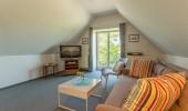 Ferienwohnung Dachlünk St Peter Ording Dorf Hund Wohnzimmer Fensteransicht